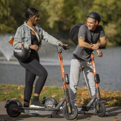 Lady & man on e-scooters